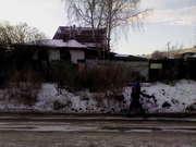 Продается  земельный  участок  с  домом  в  частном  секторе