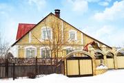 Двухэтажный уютный кирпичный дом